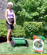 woman with garden tool and granular repellent